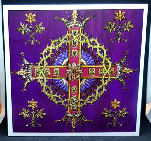 Ornate cross on purple background